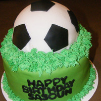 Soccer Ball Birthday Cake Decorated with butter cream for grass and the rest is fondant.