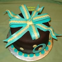 Retro Circles With Bow Strawberry cake with chocolate fondant. Teal and yellow retro circles and bow.