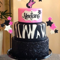 Glammed Out Rock Star  The bottom tier is a dummy cake covered in black glitter. The middle tier has a ribbon around the base because I have 2 additional cake...