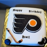 Philadelphia Flyers Strawberry Sponge filled with French Vanilla Buttercream and covered in fondant.