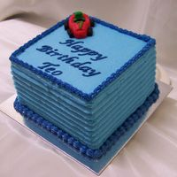 Blue Square 6 inch lemon butter cake covered in blue buttercream. Race car on top is fondant and gumpaste - idea from the motif book