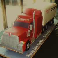 Peterbilt Tractor & Trailer Truck is three quarter sheets stacked and carved. Pieces are used to make sleeper. Both cake are on 1/2 inch MDF, Wheels are styro covered...