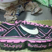 Nike Carved italian rumcake with buttercream decorations