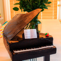 Georgia Peach Piano This was my 2nd piano cake. This one had less details and went much quicker than my 1st. My cousin I made it for, grew up in Georgia so I...