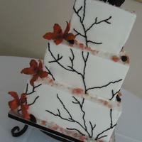 "Raven And Orchid Cake   Buttercream cake with black ""branch"" and sugar ravens and orchids."