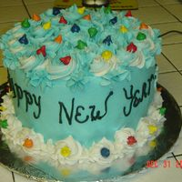 New Year's Cake 2006  I am new at cake decorating-I am inspired by the ladies on this website-ThanksThis cake is 3 layers of lemon with vanilla pudding for...
