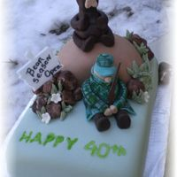 Hunter_Cake.jpg Fondant covered, fondant figures, plastic gun and sign.