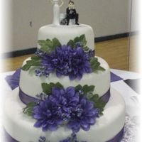Purple_Wedding.jpg Michele Foster fondant, fake flowers and ribbon.