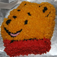 Winnie The Pooh Smash Cake Chocolate cake covered with buttercream for a 1st birthday smash cake.