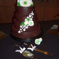Ganache White cake with chocolate ganache and suger flowers.