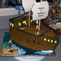 Pirates Cove 1st 3-d looking cake, wasn't what I pictured in my head, but the birthday boy loved it. chocolate buttercream frosting, plastic pirate...