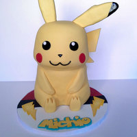 "Pikachu Pika Pika Pikachu! Oh this cake was so fun to make. Baked 3 8"" and 3 7"" vanilla cakes and filled with chocolate buttercream...."