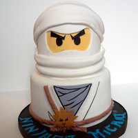 "Lego Ninjago Lego Ninjago -Two tier cake; 8"" & 6"" with Wilton half ball for head. All details made of fondant and hand painted.."