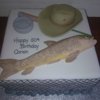 Trout Had to do a trout theme. The customer emailed me a photo of her husband's reel, hat and a fish to copy.
