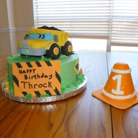 Construction Truck Construction Truck for a child's 1st birthday. Carved cake covered with buttercream and fondant accents.
