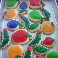 Very Hungry Caterpillar Cookies For my older son's preK graduation. Fondant on sugar cookies.