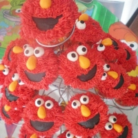 "Elmo Cupcakes For my oldest son's fifth birthday. Buttercream ""fur,"" fondant eyes, noses and mouth."