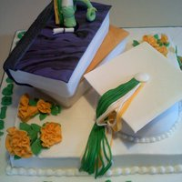 Bookds & Bookworm Graduation cake..buttercream sheet cake. Books & cap covered in fondant. Bookworm gumpaste/fondant
