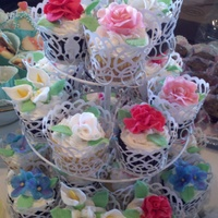 Floral Cupcakes Cupcakes for a bridal shower. Flowers are made from fondant/gumpaste mix.
