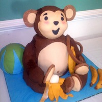 Gone Bananas Monkey iced in chocolate buttercream. Head, legs and arms are rice krispies iced with chocolate BC and tails fondant. Face and ears are...