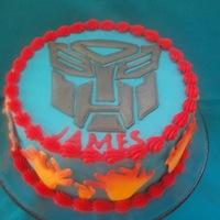 Transformers Buttercream with colorflow decorations that were airbrushed.