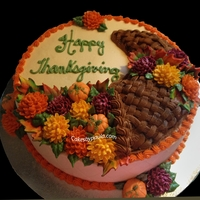 Thanksgiving iced in buttercream with fondant pumpkins and gumpaste leaves flowers are buttercream