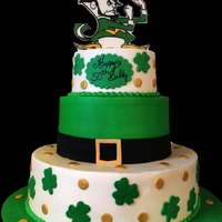 Irish iced in buttercream with fondant accents. The fighting irish man is an edible image on chocolate
