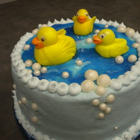 Rubber Ducky Baby Shower Cake Three tier double chocolate cake with whipped chocolate ganache filling.......... butter cream icing, and fondant ducks and bubbles...