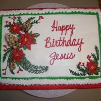 Happy Birthday Jesus Cake with Buttercream Icing. The pinecones are made with stiff chocolate icing and sliced almonds.