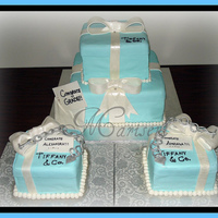Tiffany's Inspired Graduation Cake chocolate & vanilla cakes covered in chocopan/satin ice (combined to help combat humidity issues). Bows & Tiffany inspired...