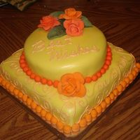 Yellow, Orange & Coral Bridal Shower Cake French Vanilla and chocolate marble cake. Frosted with Vanilla Buttercream covered with fondant. Fondant flowers were flavored with...