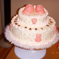 Dscn0537.jpg cake for baby shower with chocolate baby shoes, bears and letters.