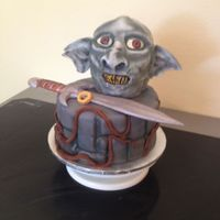 Orc Cake From Lord Of The Rings  Head carved from cake, covered in fondant and airbrushed. Bottom is a 9 inch round covered in fondant. Sting (the sword) and the ring are...