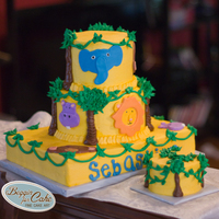 Jungle 1St Birthday 1st birthday cake designed after cake photo sent from client. Matching smash cake. Fondant animal cutouts on buttercream.