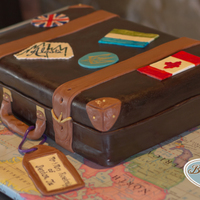 13 Sheet Grooms Cake Covered In Chocolate Fondant And Fondant Accents Hand Painted Travel Stickers Board Covered In Classroom Map  1/3 sheet groom's cake. Covered in chocolate fondant and fondant accents. Hand painted travel stickers. Board covered in classroom map...