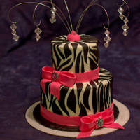 Pink Zebra Bling   Zebra birthday cake. Buttercream w/fondant stripes, ribbon and bow. Decorative buttons for bows and gem beads.