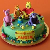 Winnie The Pooh Dark Chocolate cake with buttercream and fondant. Pooh and the rest made from gumpaste.