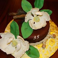 Camellia Cake 8-inch fruit cake covered in chocolate fondant that I made for my husband's birthday this year. Camellias and leaves are gum paste, &...