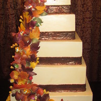 Fall Leaves Wedding Cake 5 Tier SMBC cake, Gumpaste leaves and non edibe birds the bride purchased for her cake. I Love how it came out.. The leaves could have been...