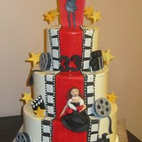 Hollywood Themed this is a buttercream, 3 tier cake with fondant accents.