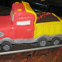 Dump Truck Fondant covered cake, crushed oreo cookie crumbs for dirt
