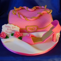 Pink Shoe & Handbag I was asked to make a handbag & shoe cake - only request was that it be pink & girly!