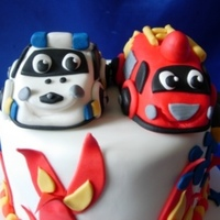 Police And Fire Engine Cake Long story with this one. The cake was ordered by a regular customer, then cancelled at the last minute (family problems/party cancelled)....