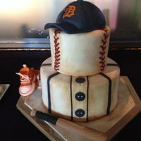 Baseball Themed Shower Cake Baseball themed cake for my daughter's baby shower. My first time covering a cake completely with fondant. It was so much fun. Fondant...