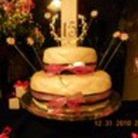 Quincenera New Year's Eve quincenera cake. Sorry for the poor quality photo. Quilted fondant dusted with pearl luster dust.