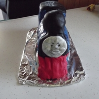 Thomas The Train White cake, covered in fondant and decorated.