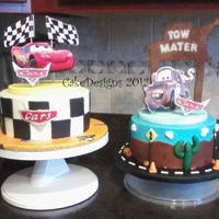 "Cars And Mater For Twins 8"" x 4"" iced in buttercream with fondant and gumpaste decorations. Styrofoam toppers. Please excuse the picture resolution it was..."