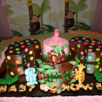 "Jungle Animals Baby Shower 6 & 10"" x 3"" and 2 satellites cakes (1/2 magnolia flower pan) iced in buttercream with fondant and gumpaste decorations"