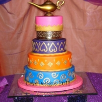 "Arabian Theme Quinceanero 6, 8, 10 &12 x 3"" for an arabian nights quinceanero iced in buttercream with fondant decorations. Gold painted with airbrush and..."