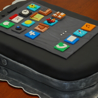 Black Iphone Cake French Vanilla cake with buttercream filling and covered with fondant
